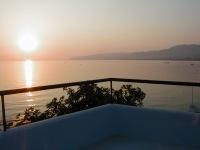 Zonsondergang vanaf een dak in Stalis - Foto van A. Braaksma