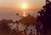 Zonsondergang op Corfu - Foto van Jan Kok